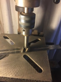 "5) The Forstner bit is mounted in the drill press, and a 1/16th"" thick ruler is used to set the depth-stop."