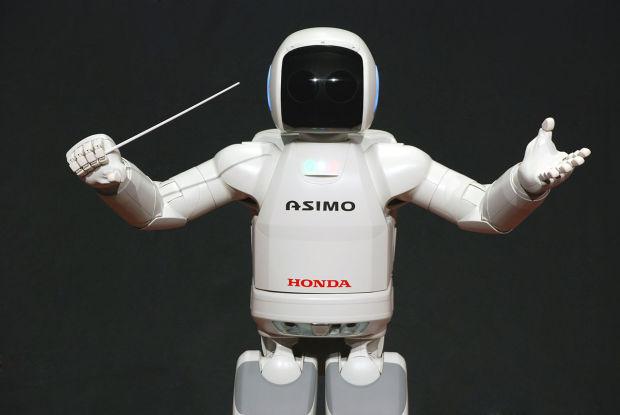 ASIMO putting his Conductor skills to good use.