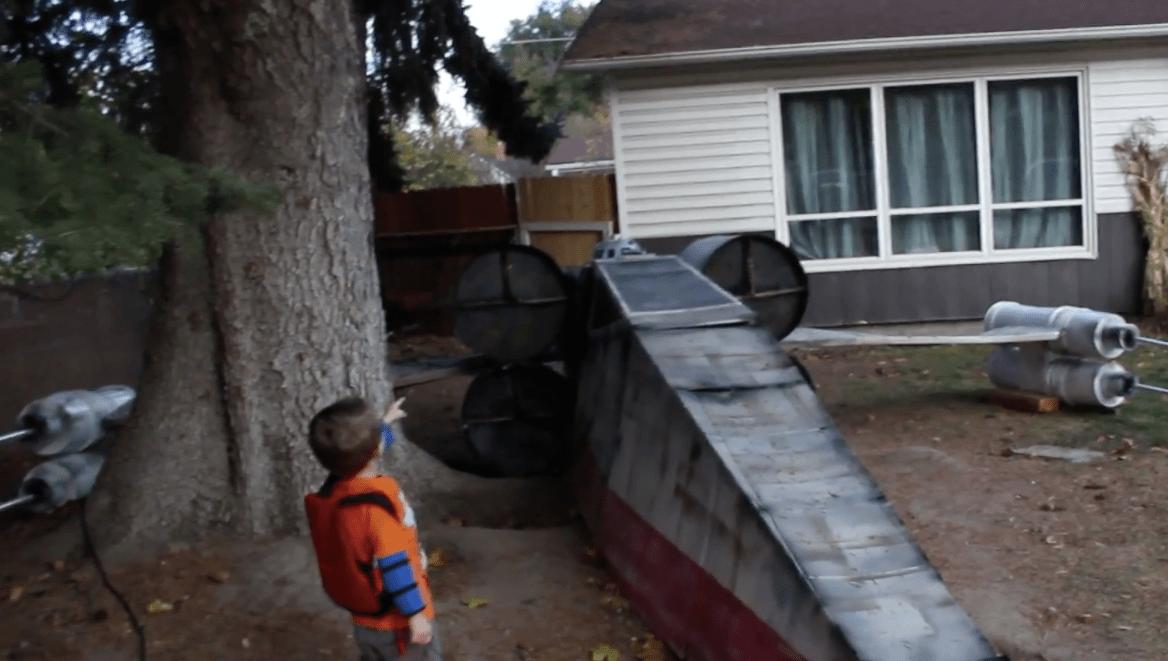 Cardboard X-Wing Crashes in Suburban Front Yard
