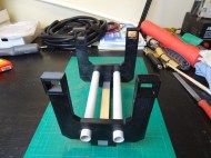 Part of the arm assembly, built with plastic electrical conduit and 3D printed parts.