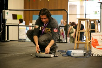 Phil Torrone teaching a workshop in how to hack Roomba robot vacuum cleaners.