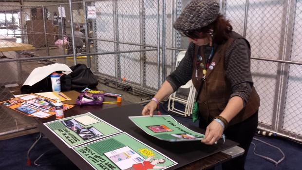 Chuck's wife Wendy preparing the 'watchdog' illustration sign.