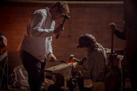 Hansi Standteiner of Mountain Forge in Truckee works during Open Forge with his son.