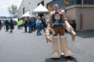 This maker stands 8 feet tall in his handmade wooden robot costume.