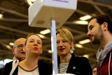 Axelle Lemarie (Left) — the French Deputy Ministry for Digital Affairs — being shown Sheldon, the host robot, a creation of maker Maxime Vallet (Right). Carine Préterre (Middle) — the Director of the Foire de Paris et Foire d'Automne — looks on.