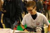 Joey Hudy teaching soldering at Maker Faire Paris.