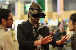A visitor to the faire tries out some of the latest Augmented Reality (AR) gear.