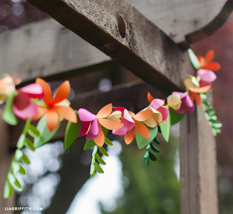 Spring time decor 3d paper flower garland make its a great way to create decor that ties into an events color scheme and they are a lot more sophisticated than your standard dollar store streamers mightylinksfo