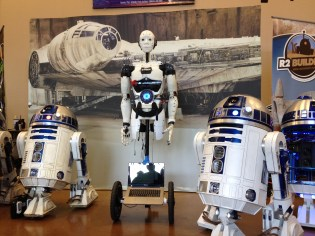 InMoov is caught in a herd of R2D2's! They almost look like distant cousins...