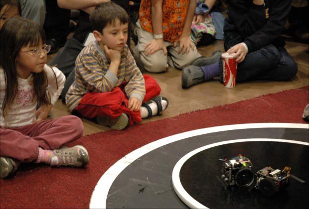 Kids show interest in RoboGames' sumo robots. Photo: Ariel Zambelich