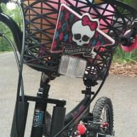 Monster High basket and emblem on front fork.