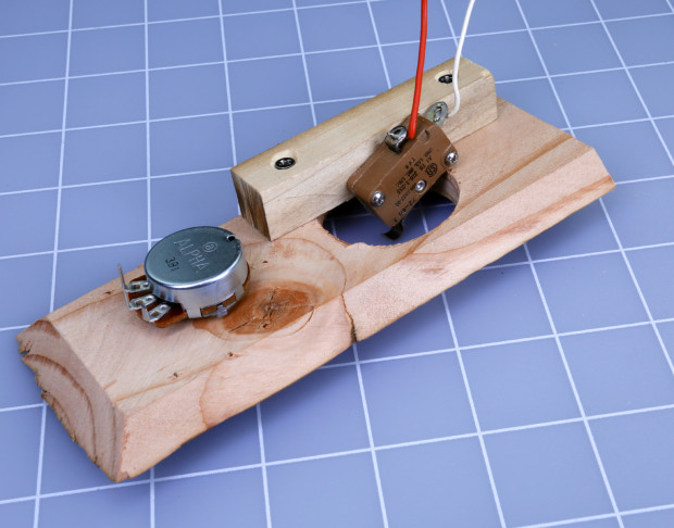 "Figure I. A snap-action switch is mounted on a piece of ½"" square poplar with #2 screws."