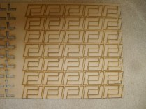 """A whole slew of main cabin rib corner connectors, cut out of 1/8"""" MDF (Medium Density Fiberboard), on the Laser Cutter."""