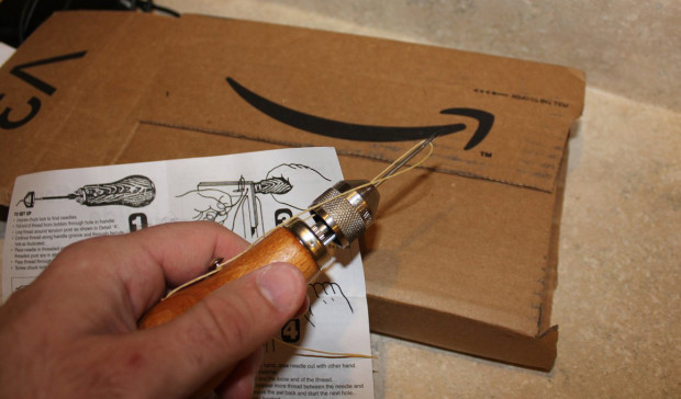 Getting ready to test out my awl on the cardboard package it came in.
