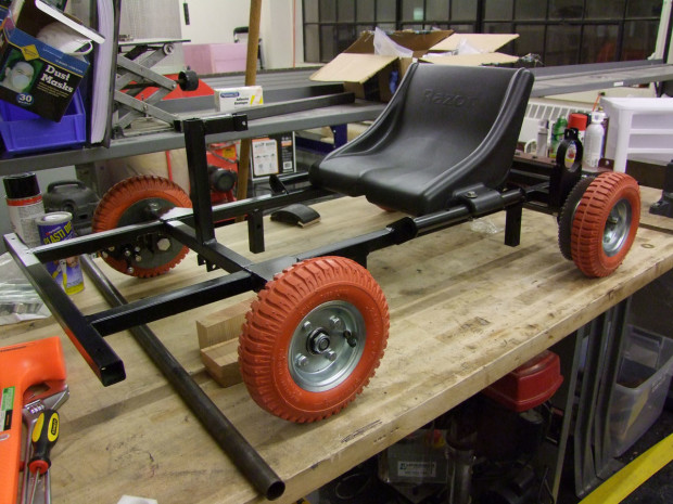 """The frame is welded from 1"""" square steel tubing, the wheels were supposed to be for handtrucks, and the brakes were taken from the electric scooter parts bin."""