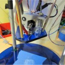 Rubber Bands and Fishing Line Make a Low-Budget 3D Printer
