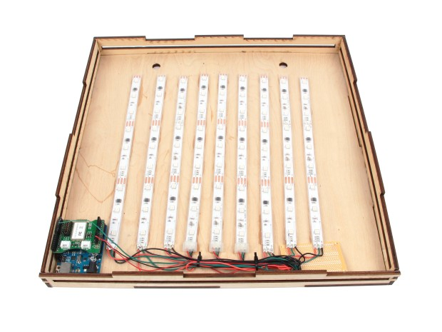 A laser cut box holds the LED strips and arduino