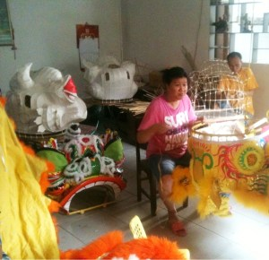 Factory workers making a dancing lion costume.