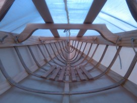 Inside a Greenland kayak, showing detail of bent wood and lashing