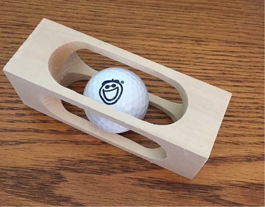 Golf-Ball-inside-a-block-of-wood-2