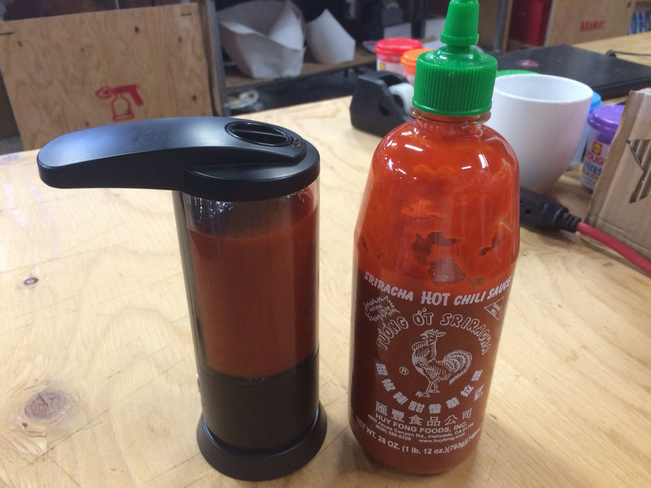 The Easiest Hands-Free Sriracha Dispenser Ever