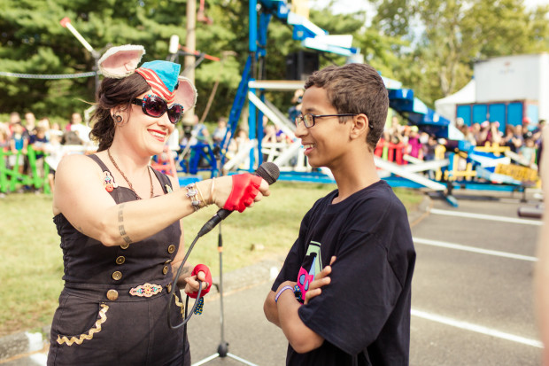Ahmed gets ready to turn the crank at the giant Mouse Trap. (Photo: Hep Svadja)