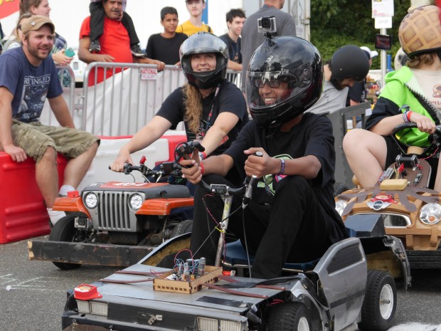 """Ahmed at the wheel of the """"Hack to the Future"""" car from the HackPGH Power Wheels team. (Photo: Jordan Bunker)"""