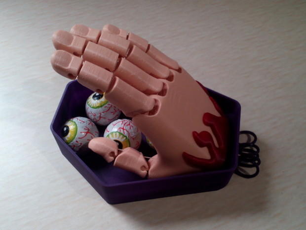 GyroBot's Hell-oween Flexy-Hand is sure to scare little kids who try to grab candy from this dish.