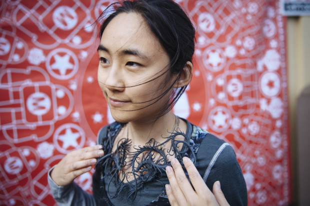 Zoa Chimerum shows off her 3D printed necklace. Photo: Becca Henry