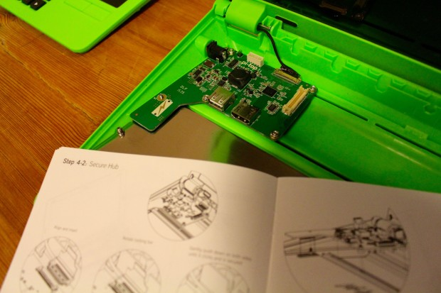 Attaching the Hub board to the base of the Pi-Top.