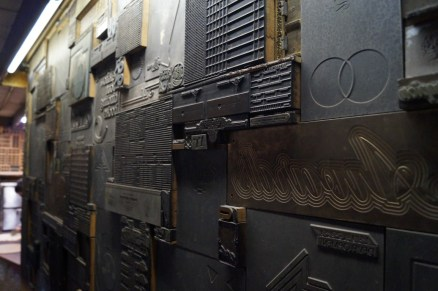 Printing plates covering a wall