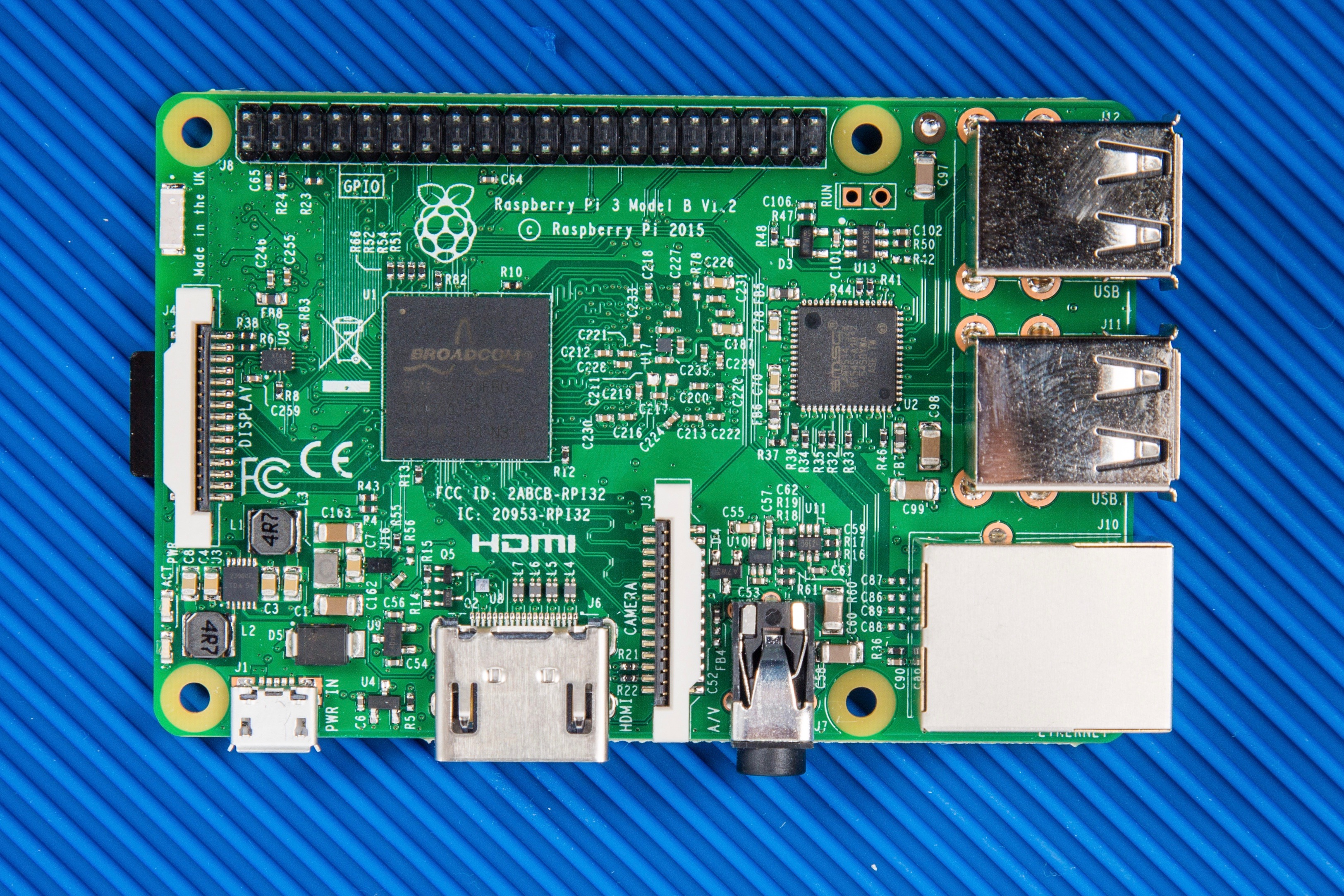 The New Raspberry Pi 3 With Wi Fi And Bluetooth Make Or Photo Of Computer Electronic Circuit Cpu Board Breaking Binary Code Front Side Broadcom Bcm2837 Systemonchip Centre Left Smsc Lan9514 Usb Ethernet Controller Right