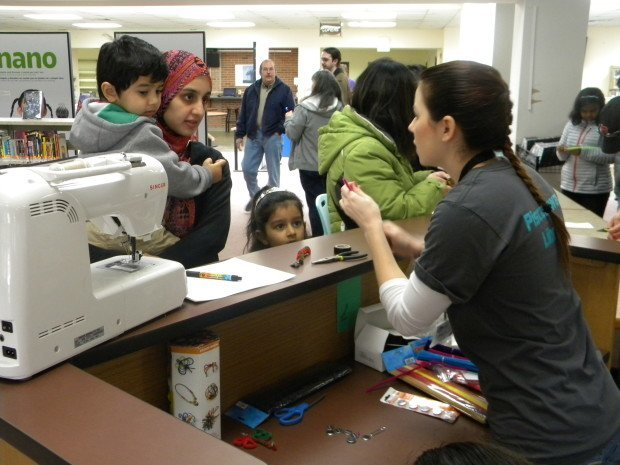 New Jersey Makers Day 2015 volunteer helps kids make their own magic wands at the Piscataway Public Library.