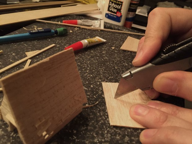 Then I cut the flaps into sections to make the individual shingles.