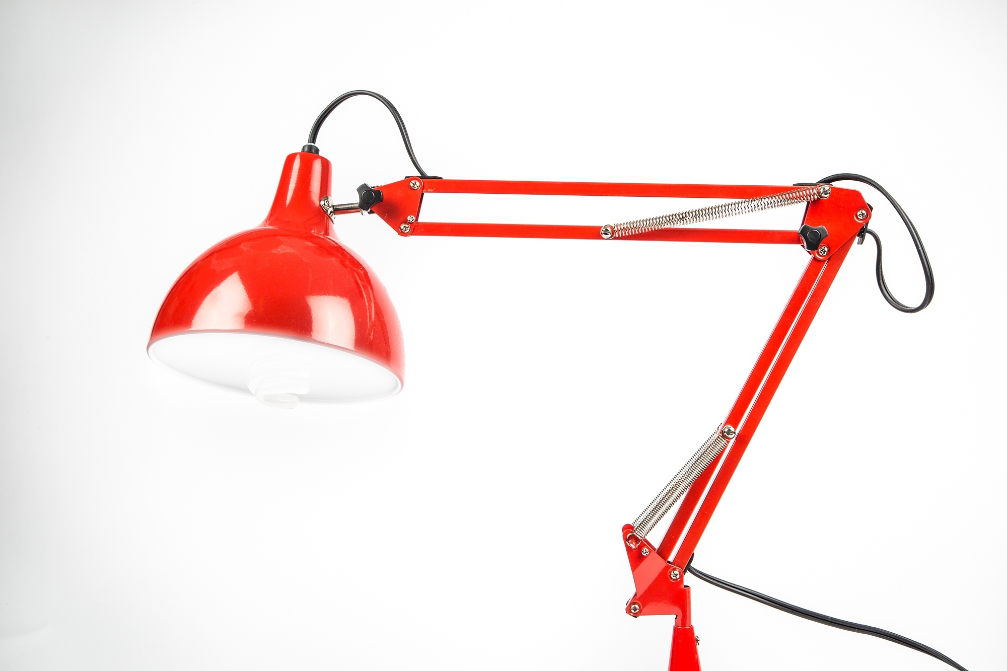 Red 4 bar linkage arm lamp with light shining downwards.