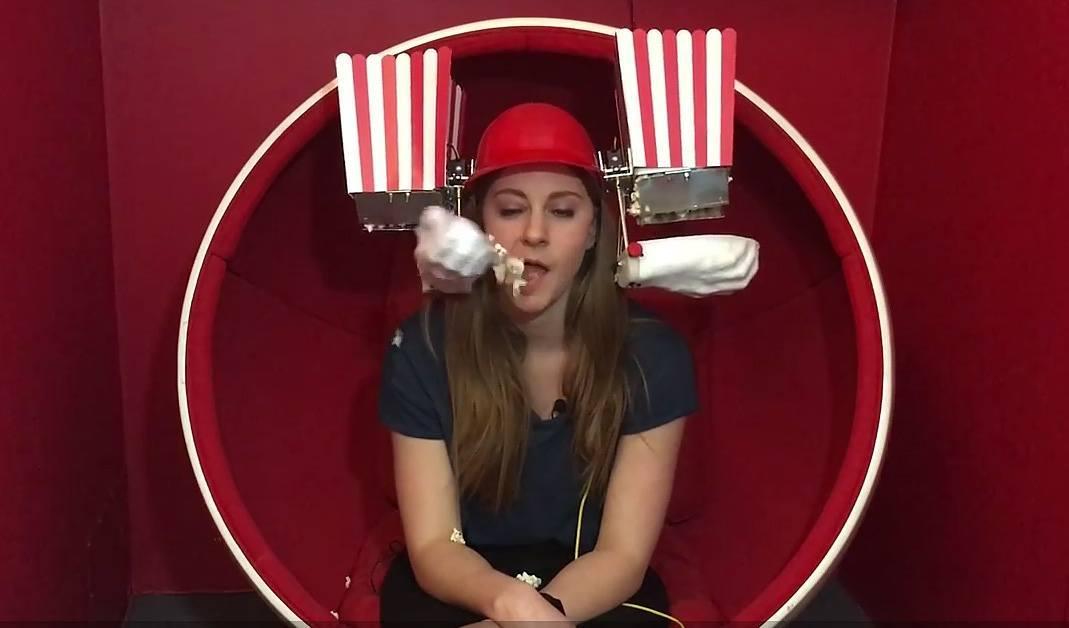 """Simone Giertz Joins """"Tested,"""" Builds Popcorn Feeding Helmet"""