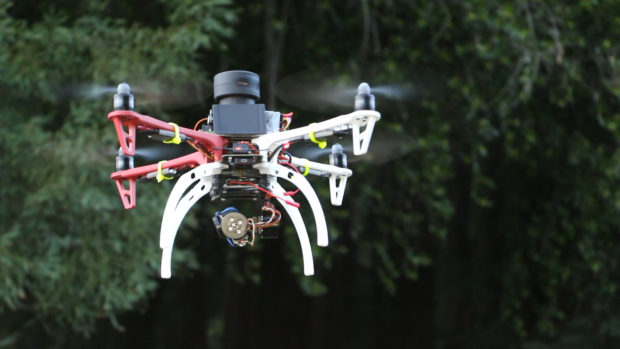 Roughly the size of a hockey puck, and just over a quarter pound in weight, Sweep is one of a few new lidar devices that hobbyists can access for experiments like aerial drone mapping. Photo courtesy of Scanse