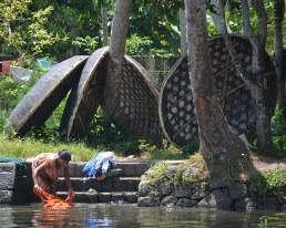 Image of boats on a river in Kerala from a recent Slow Fiber Studios travel program to India.