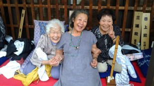 Yoshiko in Arimatsu, Japan with shibori artisans who she has worked with for more than 30 years.