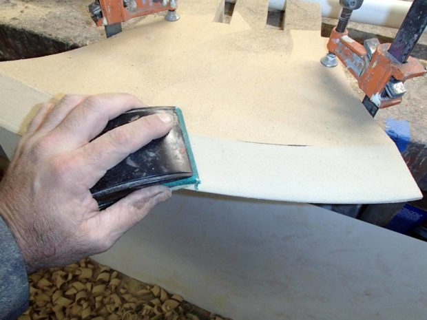 FIGURE 1-19: Fine-tuning the blade shape with a sanding block