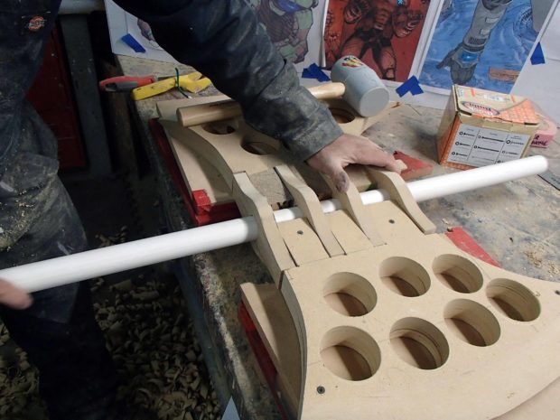 FIGURE 1-23: Keeping the handle in place makes sure that the holes will line up properly.