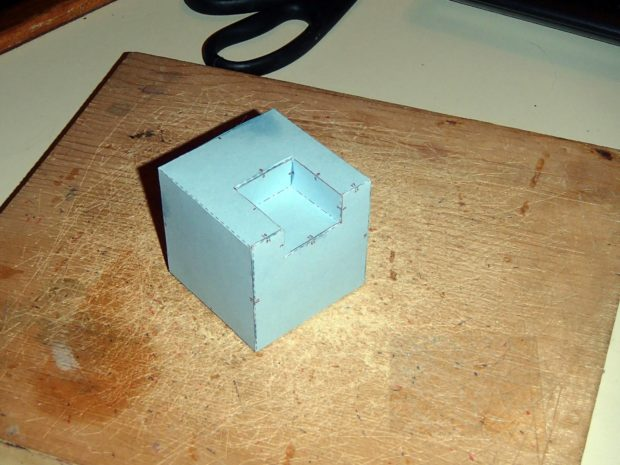 FIGURE 2-12: A paper cube with a notch in it
