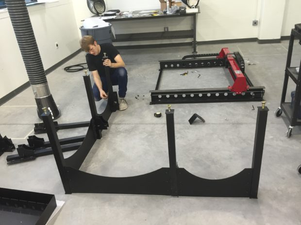 Digital Operations Manager Harrison Tyler putting together our Torchmate CNC plasma cutter. Photo by Will Holman