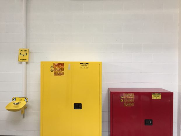 Flame cabinets for volatile chemicals, finishes, and solvents, right next to our eye wash station. Safety first! Photo by Will Holman
