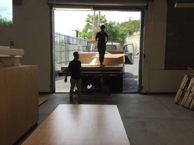Unloading tons of plywood for furniture fabrication. Photo by Will Holman