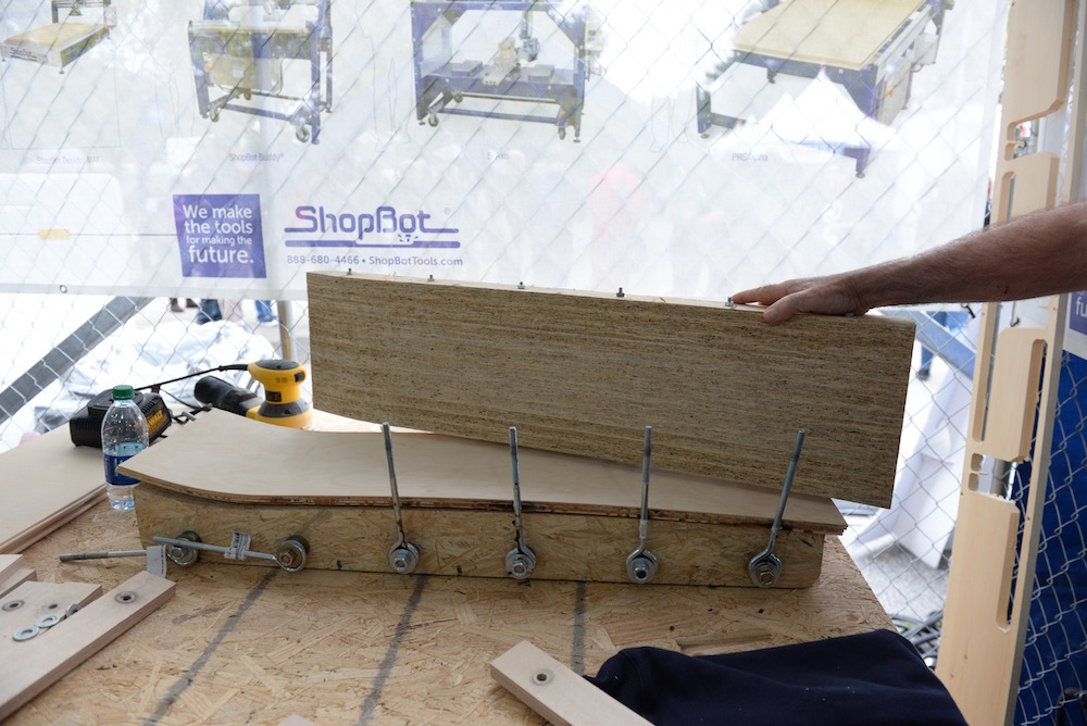 Shopbot's skateboard press, a shaped mold to form layers of baltic birch into contoured skateboard. (Sunday, Mike Senese)