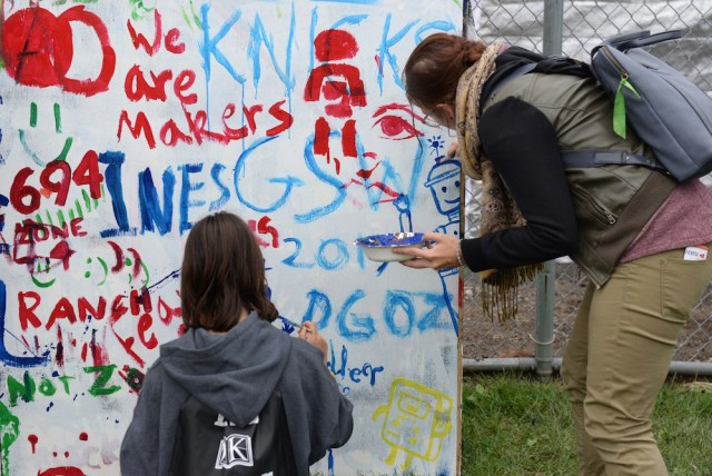 Attendees getting creative with a painting mural. (Sunday, Mike Senese)