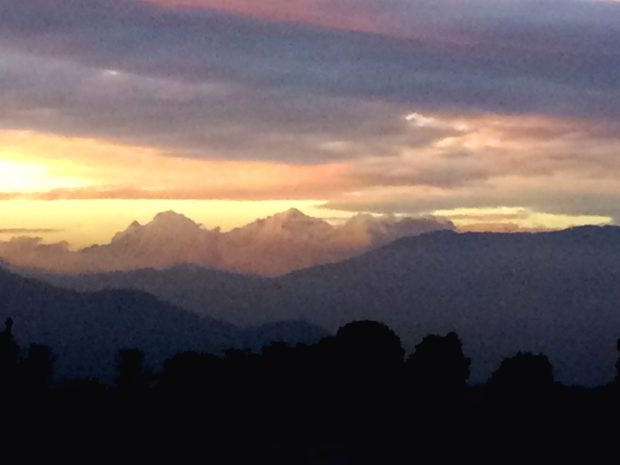 A rare moment when the clouds cleared and you could see the Himalayas at sunset from Kathmandu.