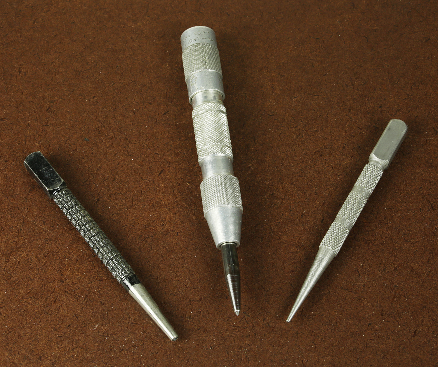 Figure 10. A nail set, a center punch, and another nail set.