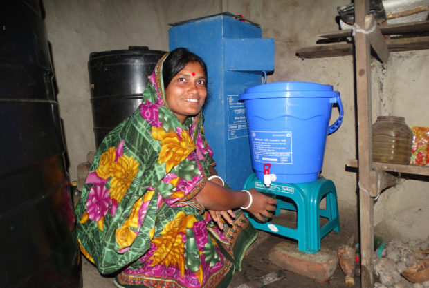 Bijoli_Sarder_gets_herself_a_glass_of_water_in_Bangladesh